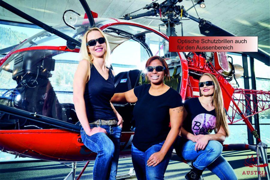 3 Damen mit Korrigierten Arbeitsschutzbrillen vor rotem Helikopter im Hanger